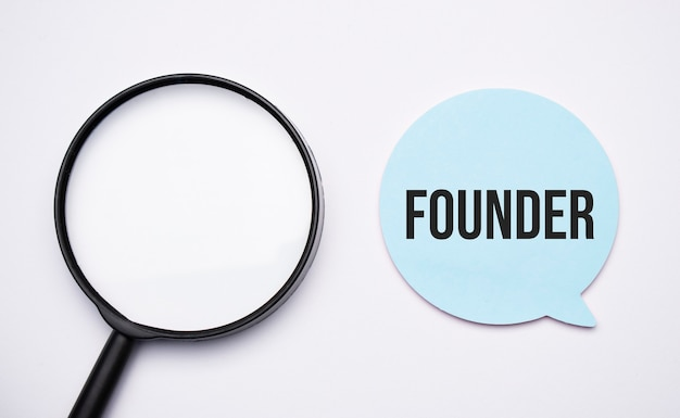Founder speech bubble and black magnifier isolated on the yellow background.