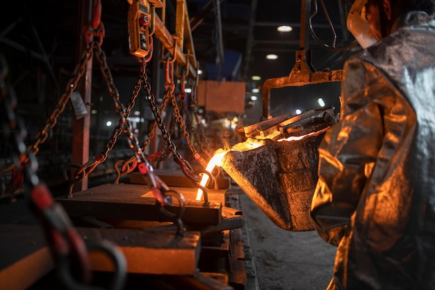 Foundry casting and process of pouring liquid molten iron, metallurgy and heavy industry.