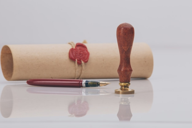 Fountain pen and old notarial wax seal on document