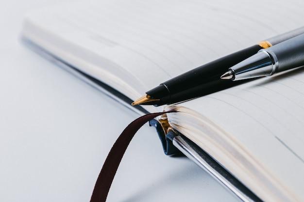 Fountain pen on open notepad