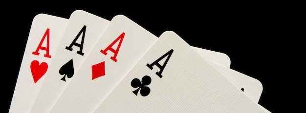 Four aces on black background