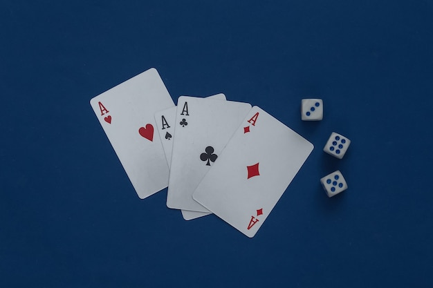 Four aces and dice on a classic blue.