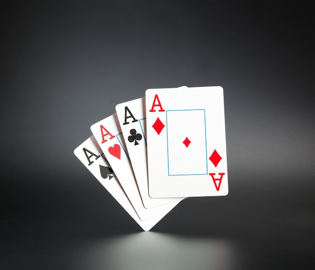 Four aces on grey