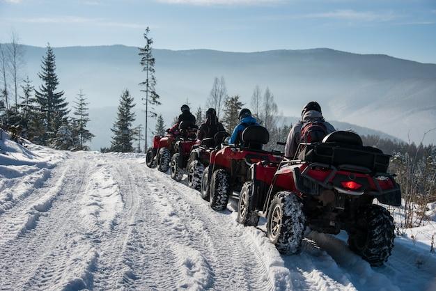 Four atv riders on off-road quad bikes