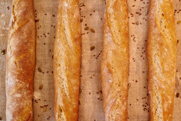 Four baguettes on a textile