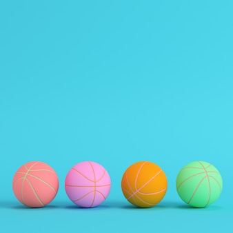 Four basketball balls on bright blue background