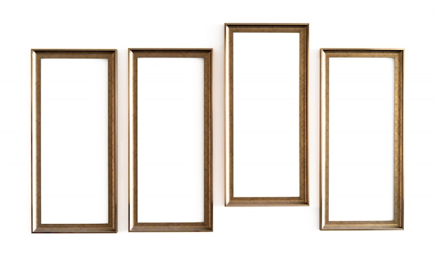 Four blank golden wood photo frame on white concrete wall
