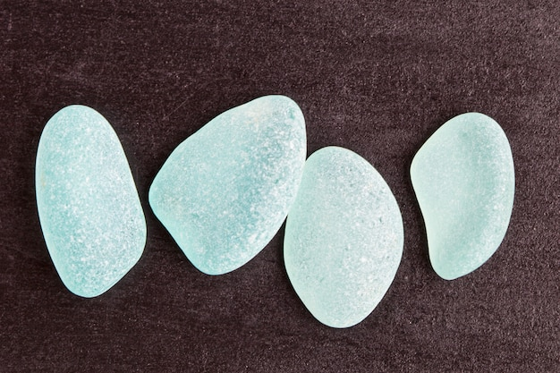 Four blue glass pieces polished by the sea