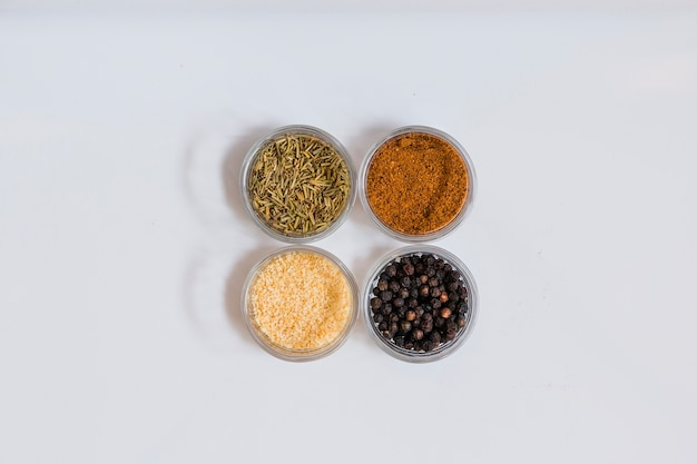 Four bowls with spices