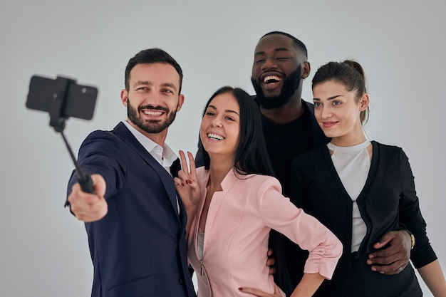 The four business people making selfie