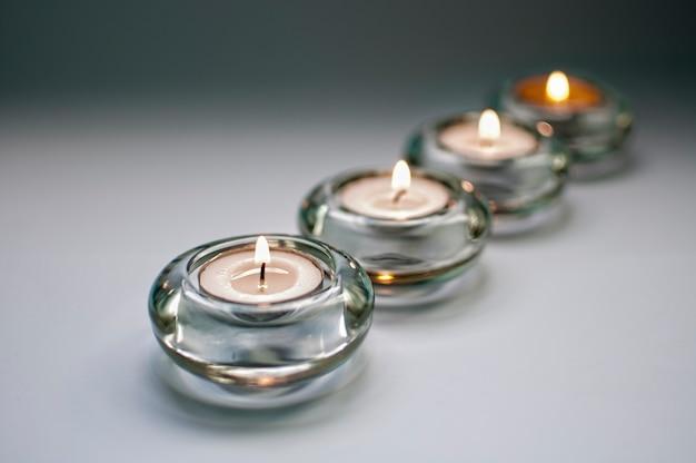 Четыре свечи на сером фоне