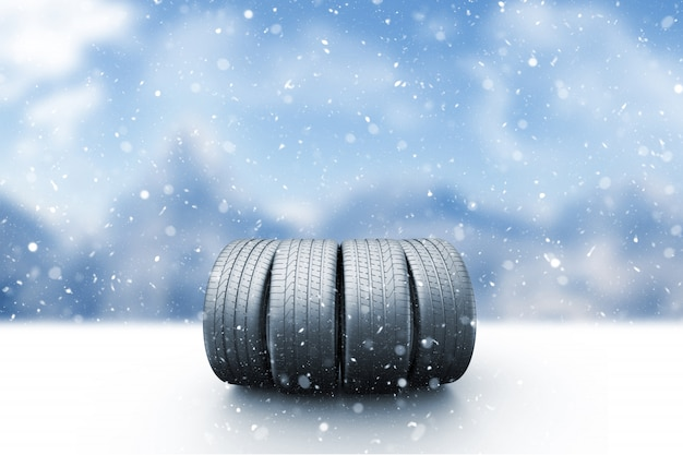 Four car tires on a snow covered road