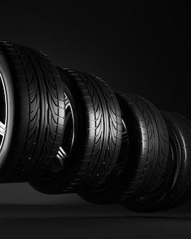 Четыре колеса автомобиля на черном фоне.