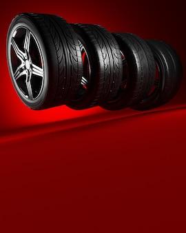 Четыре колеса автомобиля на красном фоне