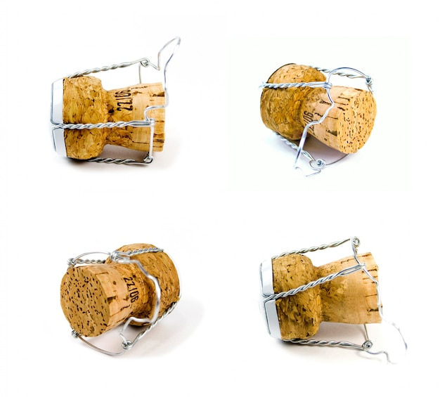 Four champagne corks on white background