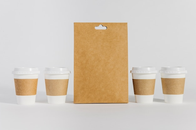 Four coffee cups and bag