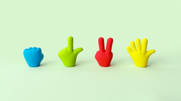 Four colorful cartoon hands set. symbols of rubber toy hands