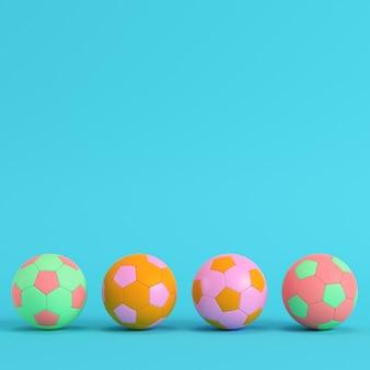 Четыре красочных футбольных мяча на ярко-синем фоне