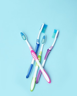 Four colorful toothbrushes