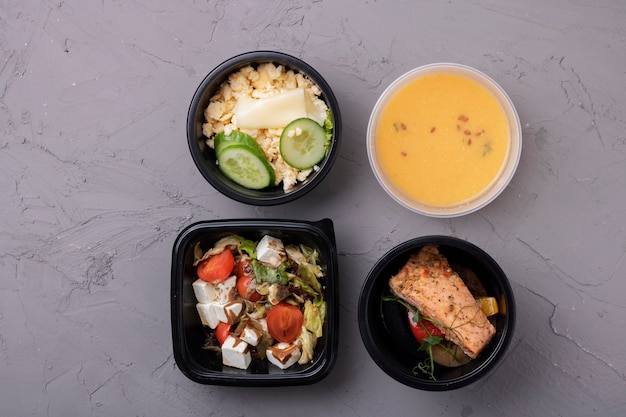 Four containers with meal, flat lay