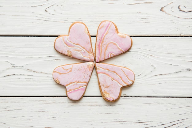 Four cookies in the form of a marble heart stacked flower clover