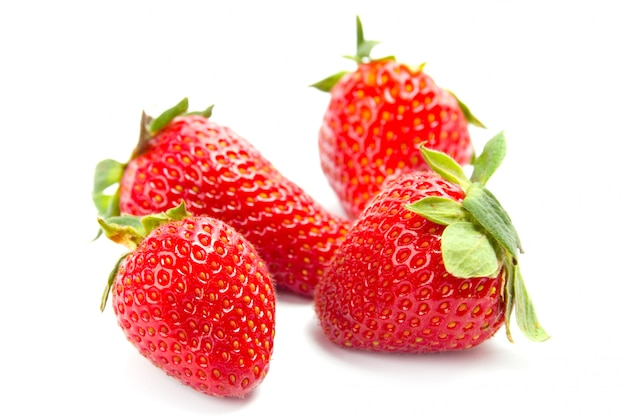 Four fresh strawberries on white background