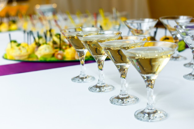Four glasses of champagne on the banquet table