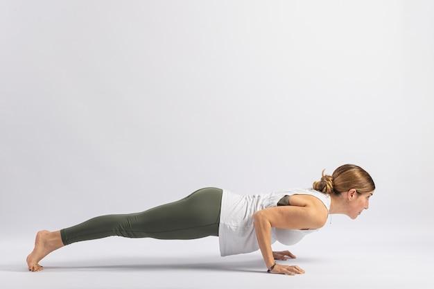 Four-limbed staff pose (chaturanga dandasana) yoga postures (asana)