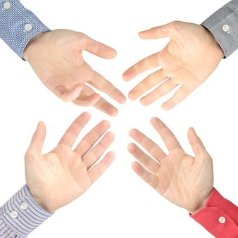 Four male hands stretched out to each other on a white space. discussion, help and social relations. diplomacy and sign language between opponents