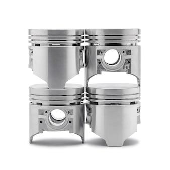 Four new pistons isolated on white background. automotive engine parts.
