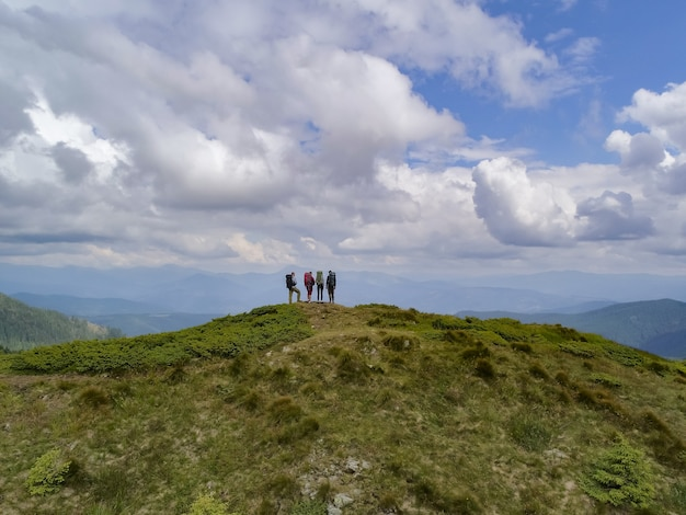 The four people standing on the picturesque mountain