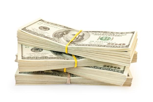 Четыре стопки долларовых купюр изолированы