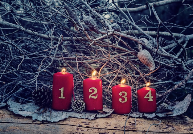 Four red advent candles with numbers