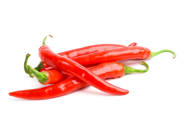 Four red chili peppers isolated on white background