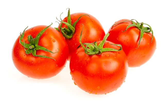 Four red wet tomatoes isolated