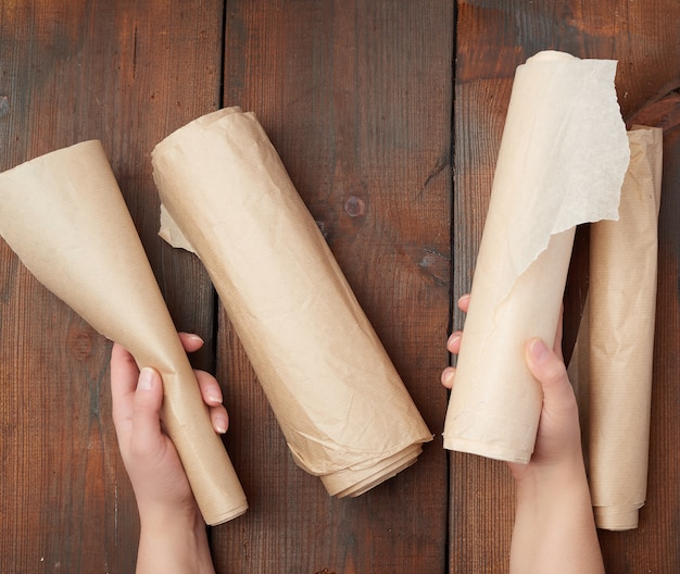 Four rolled rolls of brown parchment paper