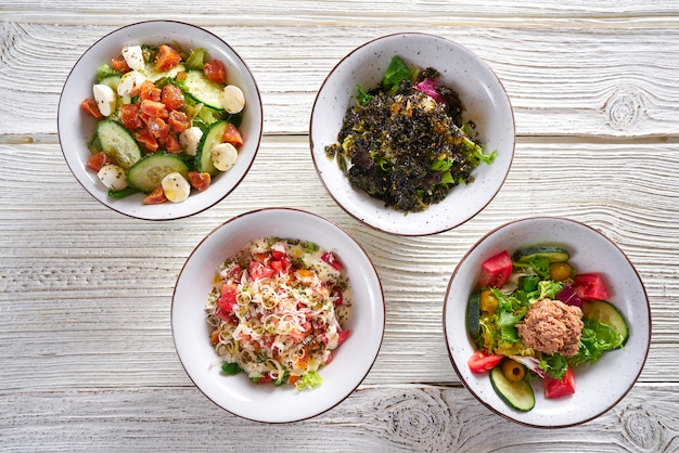 Four salad mix bowls healthy food