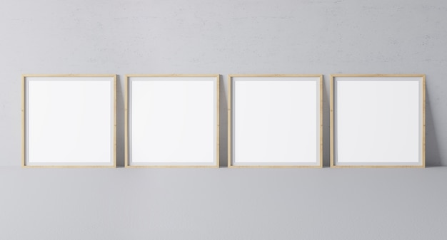 Four square wooden frames in modern design on minimal gray wall