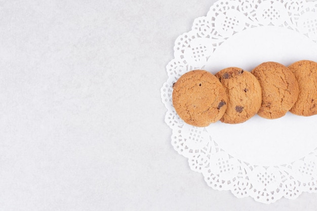 Four sweet cookies on white table .