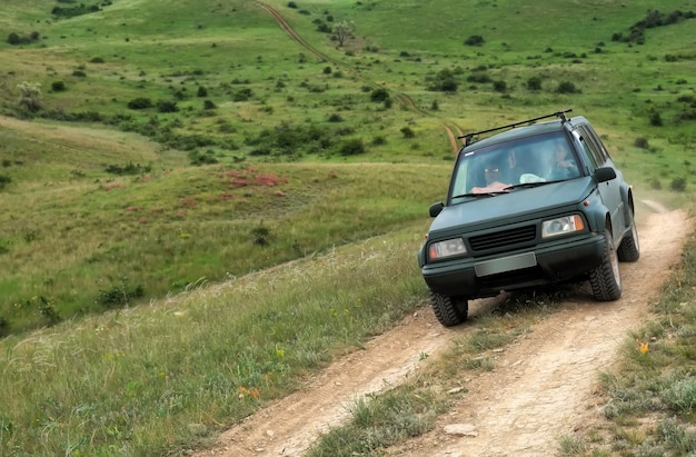 Four-wheel drive suv car crossing mountain road in crimea
