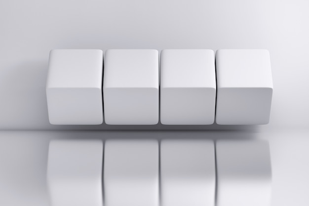 Four white large cubes over white mirror surface background