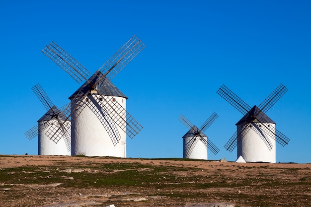 Four windmills in field