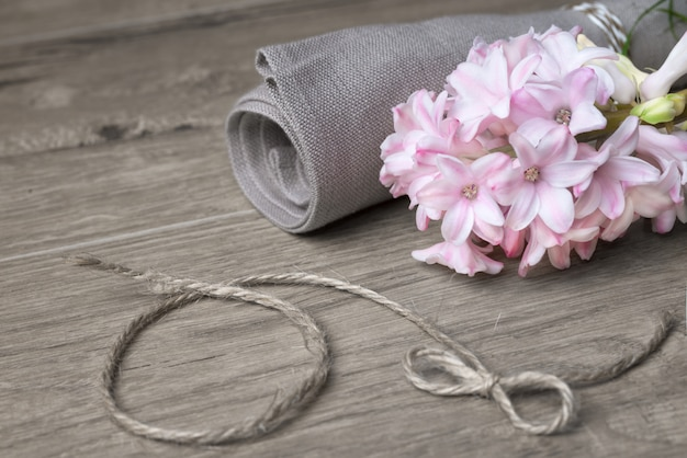 Fragile pink hyacinth and linen napkin