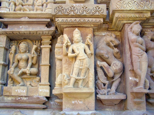 Fragment of ancient bas-relief at famous erotic temple in khajuraho, india