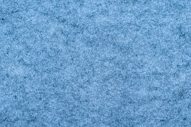 Fragment of blue carpet texture as a background.