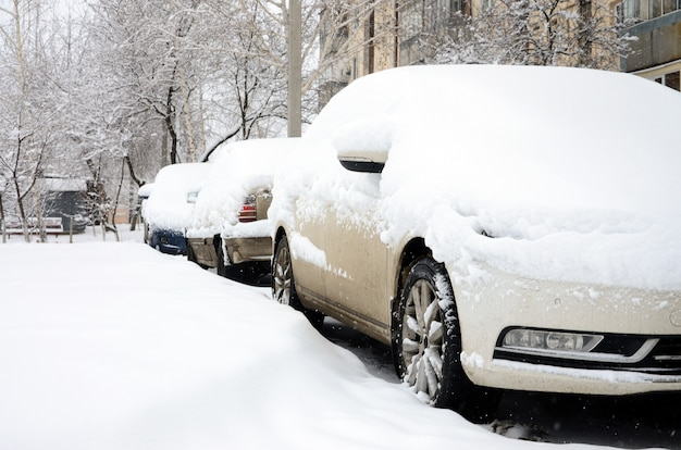 Fragment of the car under a layer of snow after a heavy snowfall.
