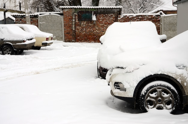 Fragment of the car under a layer of snow after a heavy snowfall