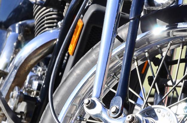 Fragment of chromed shiny wheel of old classic motorbike