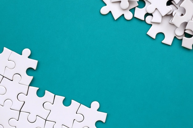 Fragment of a folded white jigsaw puzzle and a pile of uncombed