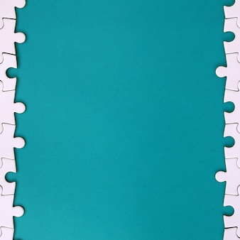 Fragment of a folded white jigsaw puzzle